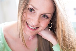 Blonde girl with braces smiling